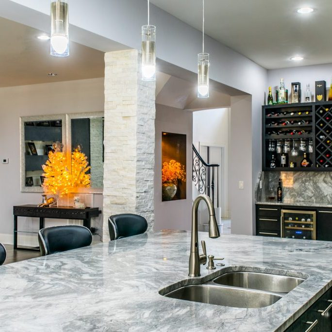 Marble kitchen island bar renovation by East Coast Granite of Wilmington