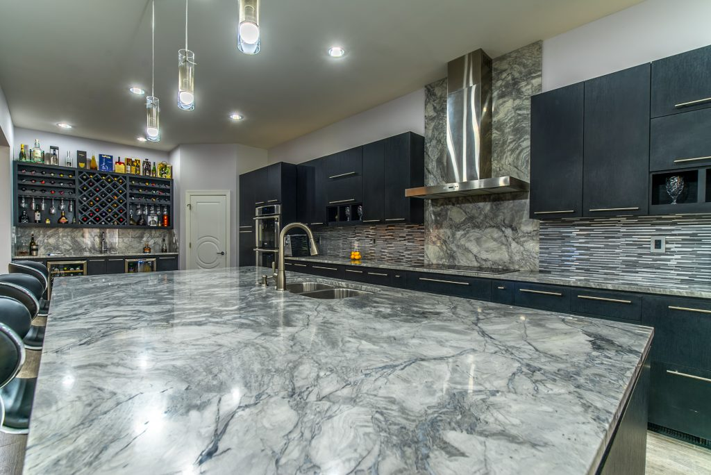 Marble kitchen island with sink installed by East Coast Granite of Wilmington
