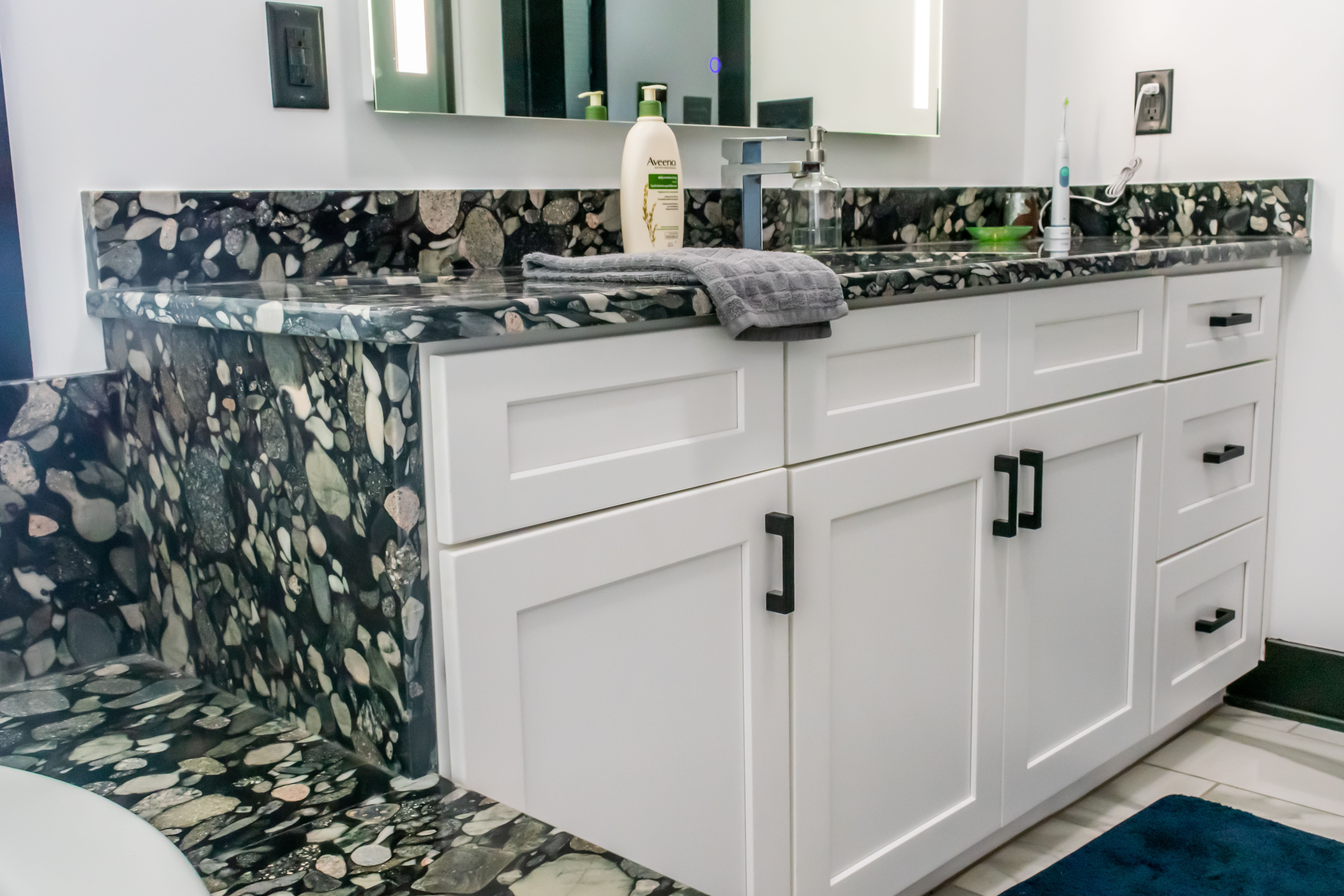 Black Mariachi Granite Vanity Tops And White Cabinets With Custom Tub Surrounds