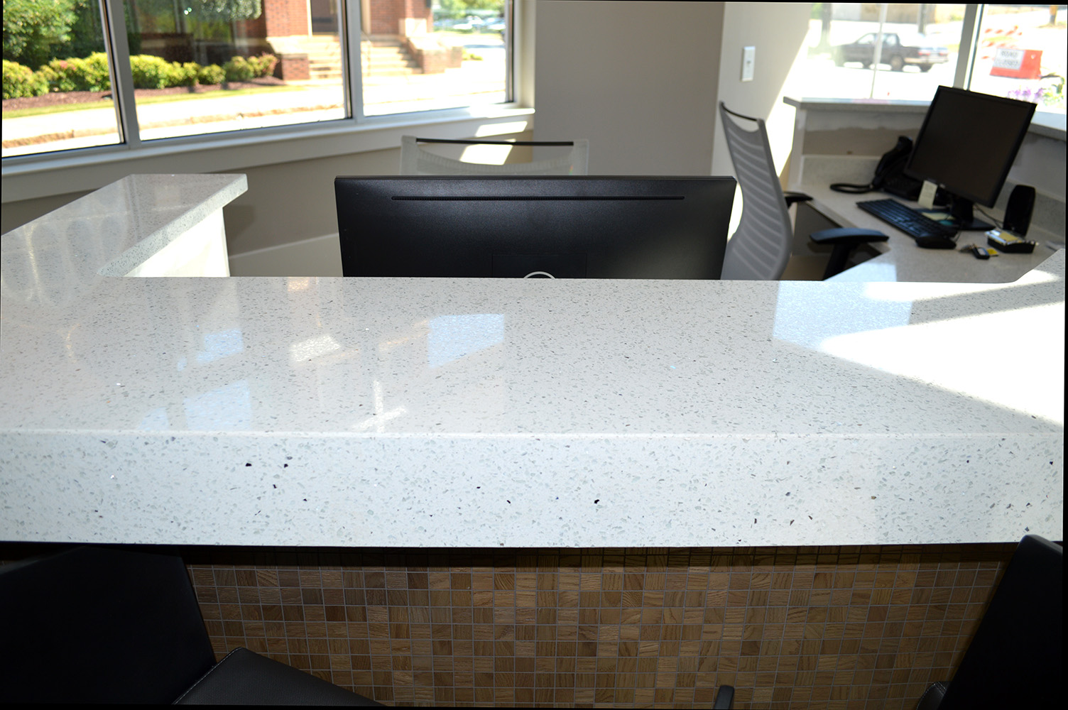 East Coast Granite installed this beautiful White quartz countertop on a receptionist's desk at Link apartments in Greenville, SC
