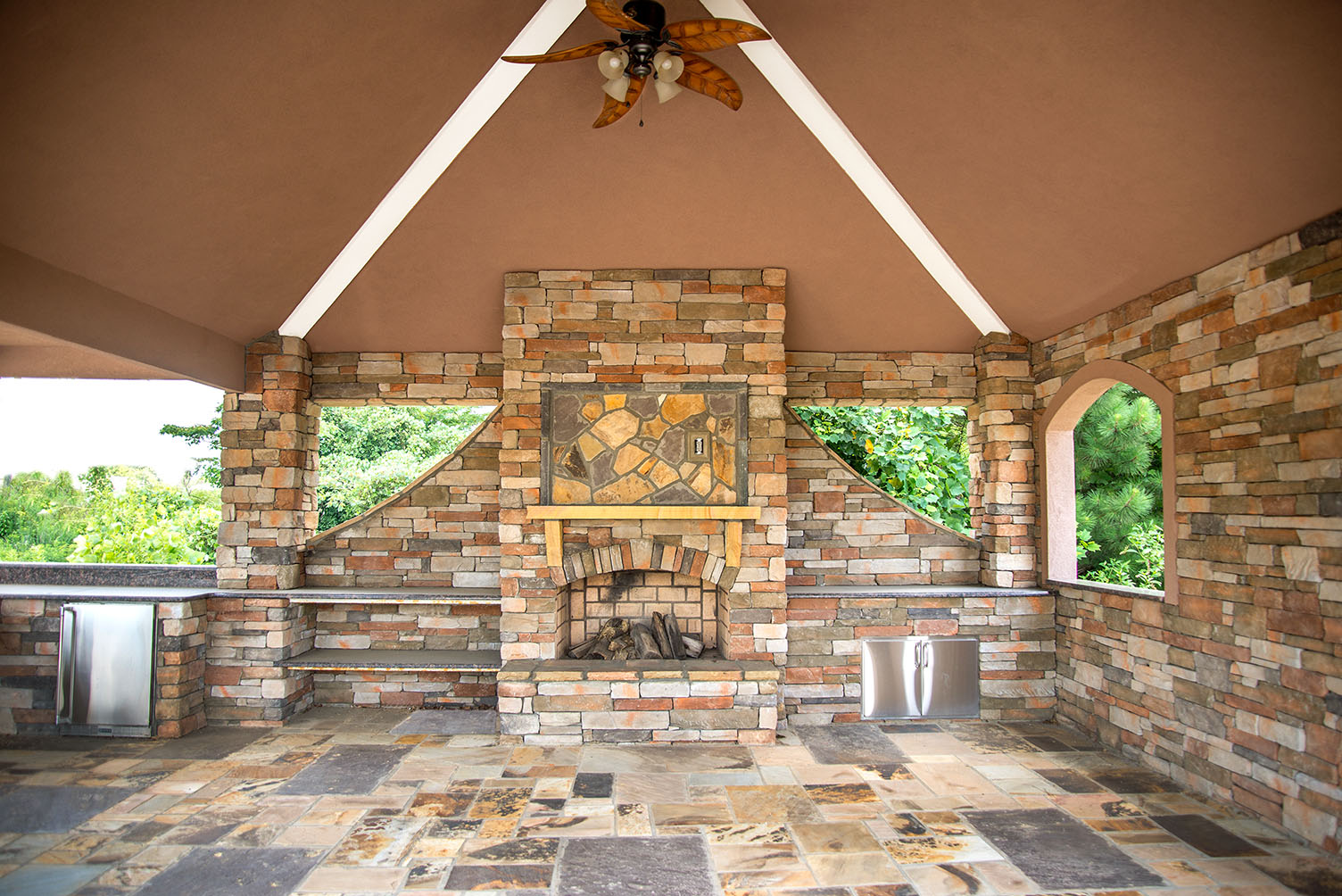 Covered outdoor living area with fireplace