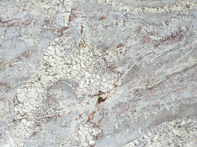White Springs granite countertops feature a bright white background with multiple shades of gray in its veins